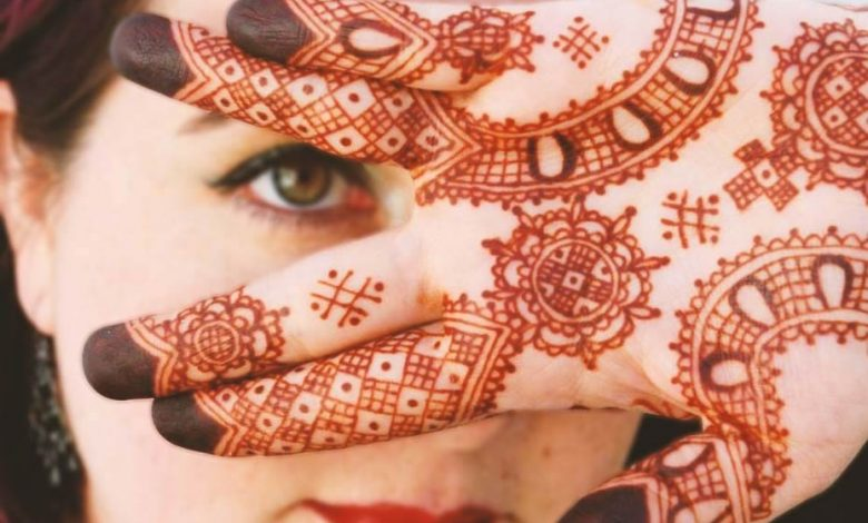 Woman with Moroccan henna tattoos in her hand