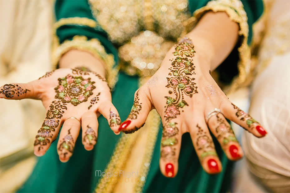 Hand's bride with henna tattoos in Morocco during a wedding