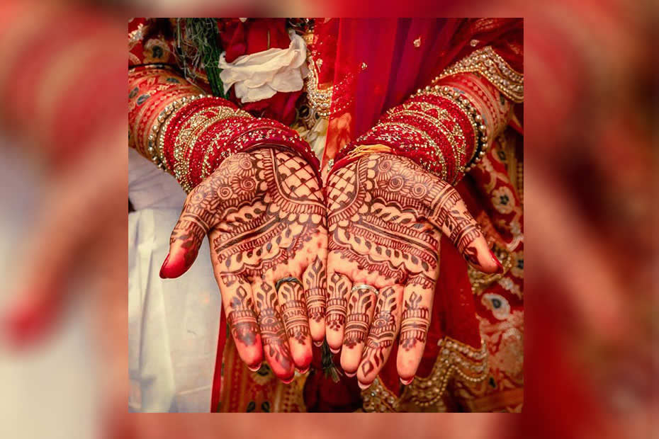hands with mehndi tattoos