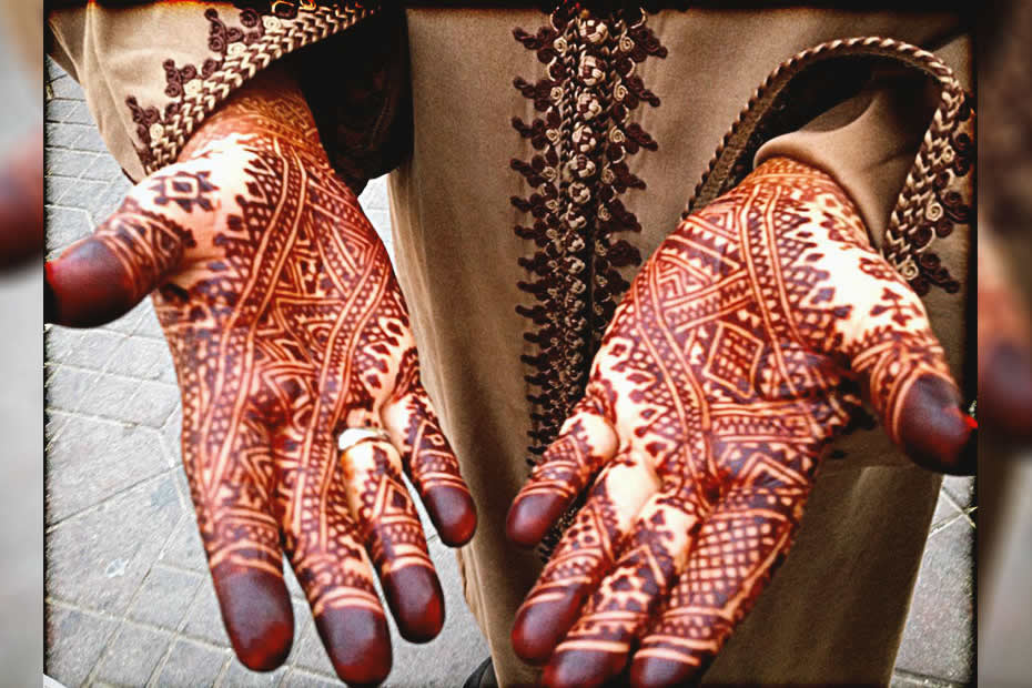 Moroccan henna tattoos on both of a ladies hand