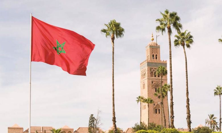 Koutoubia Mosque in Marrakech and the Moroccan flag