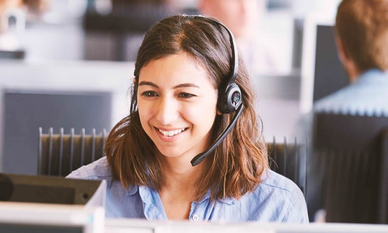 A brown headed girl in a call center