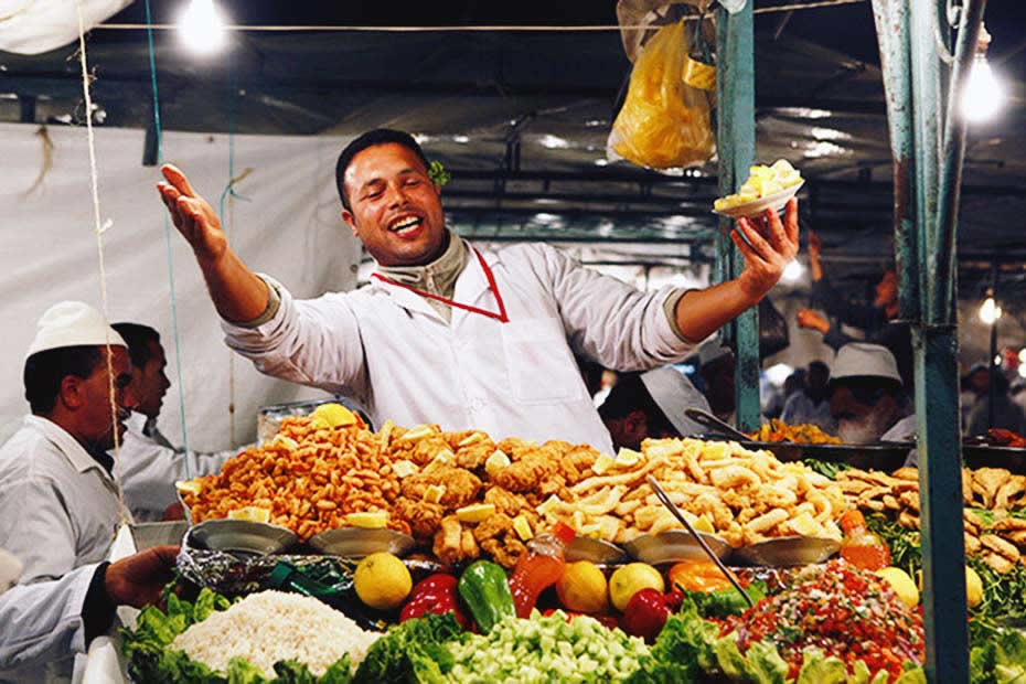 A Moroccan man selling food and street food in Marrakech
