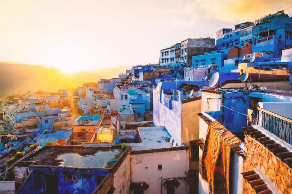 Fascinating view at sunset of Chefchaouen blue houses located in the hills of the rif