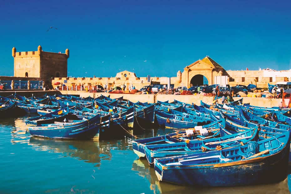 View of Essaouira's famous port and blue boats