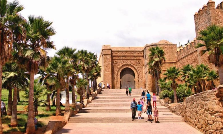 The Kasbah of the Udayas in Rabat, Morocco, with locals and tourits walking on the stairs.