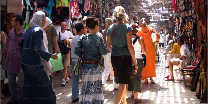 tourists in safety in a souk in morocco
