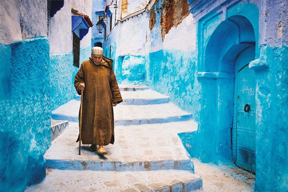 A Moroccan man wearing a jellaba in Chefchaouen, Morocco