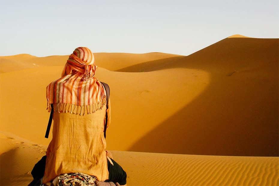 Someone in the Sahara desert of Morocco