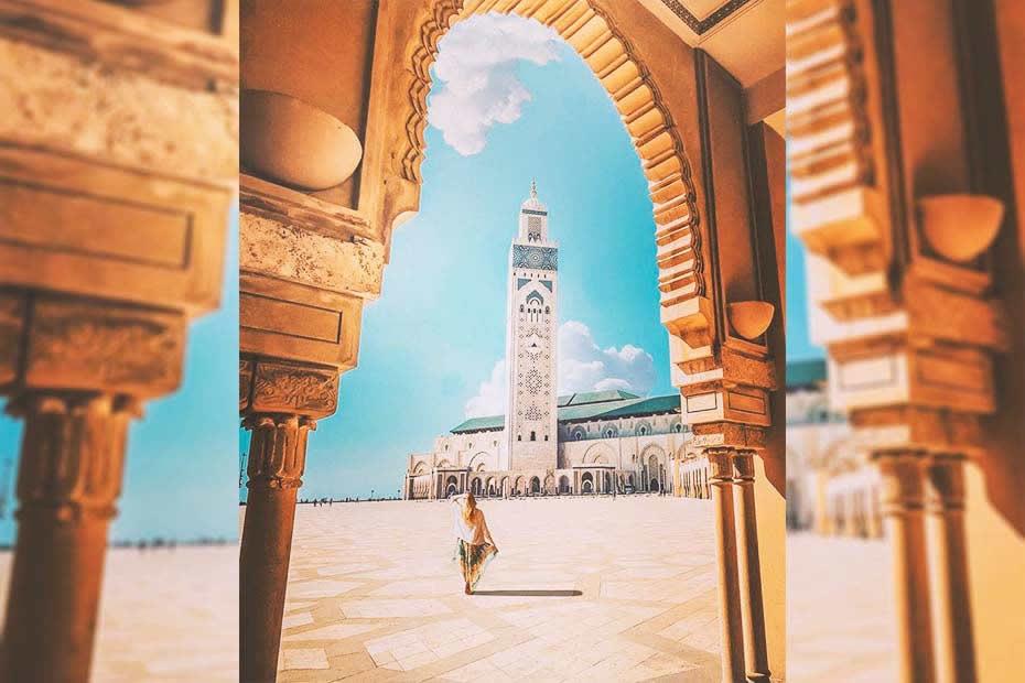 Casablanca versus other Moroccan cities: girl visiting the Casablanca mosque Hassan II