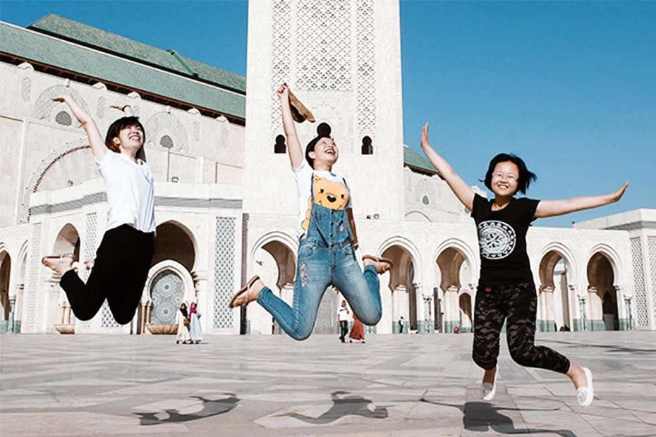Casablanca place to visit: Tourists jumping in front of the Casablanca mosque Hassan II