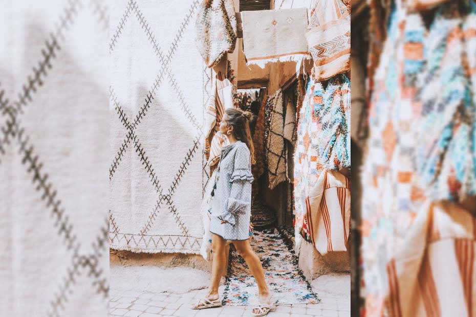 A Western woman wandering through a Moroccan souks in search of what to wear in Morocco.