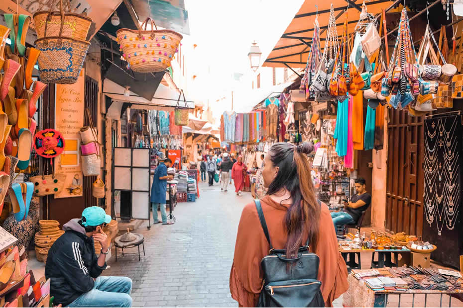 A Western woman wandering through a Moroccan souk in search of what to wear in Morocco.