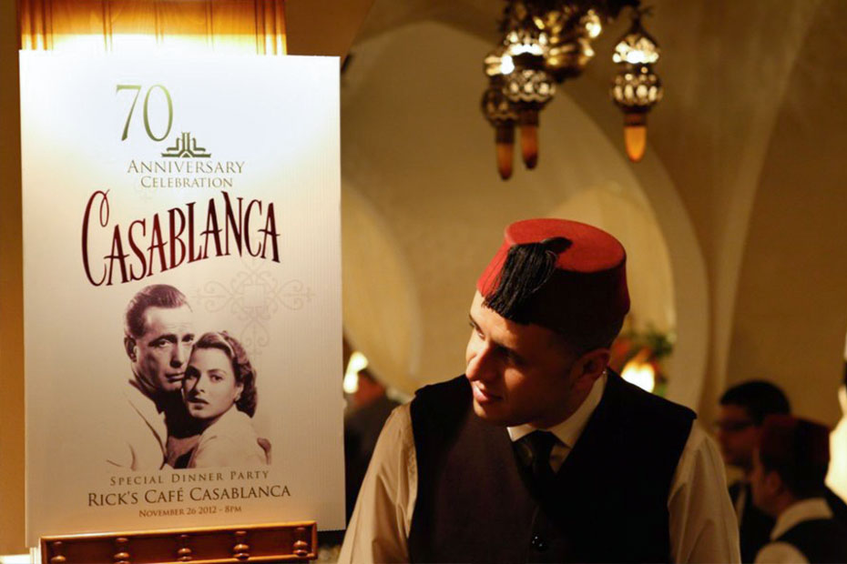 a waiter looking at the casablanca movie poster
